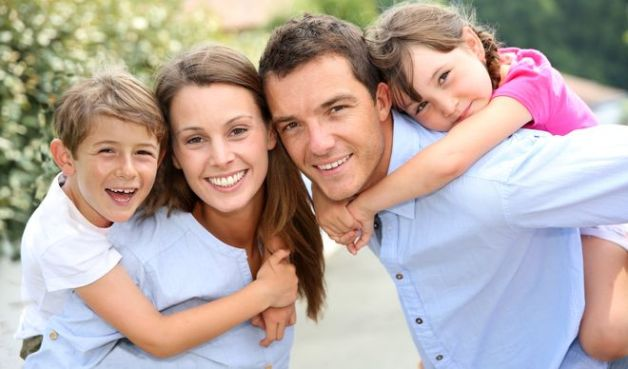 Portrait of happy family with young kids